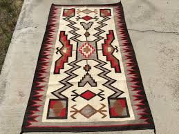 aside from the little bit of the red color fading on one side this 1930 s jb moore storm pattern crystal vintage navajo rug