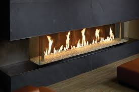 this fireplace features a contemporary three sided glass design that showcases the fire from multiple view points and provides a dramatic focal point in any