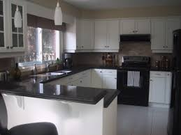 Small Picture Kitchen with white cabinets and black appliances counter For the