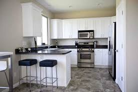 black and white kitchen with grey walls