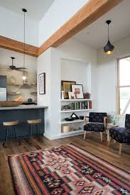 bliss ann lowe s mason river home built in storage floor breakfast bar paint color bar stools exposed beams white walls
