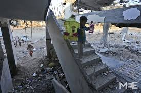 ramadan amongst the rubble of gaza middle east eye a child carries the fanoos traditional ramadan lanterns which will be suspended to the roof of the house mee mohammed asad