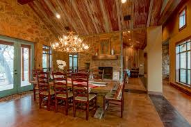 rustic dining room with intricate antler chandelier