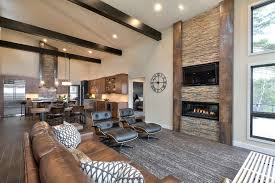 modern rustic living room living room rustic with brown sofa gray area rug dark ceiling beams