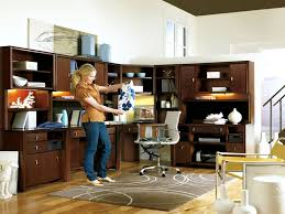 person home office. Brown Wooden Long Desk With Shelves And Storage Combined White Modern Armchair Placed On The Person Home Office F