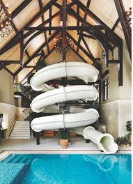 Homes The Tubular Water Slide Takes Advantage Of The Pool Areas Cathedrallike Ceiling photo By Martin Tessler Winduprocketappscom Calgary Funhouse complete With Slide Western Living