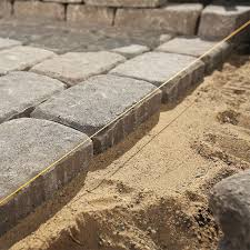using strings to keep the paving stones straight
