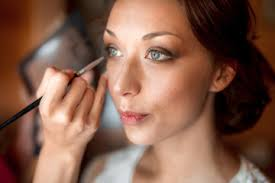 process of making makeup make up artist working with brush on model face