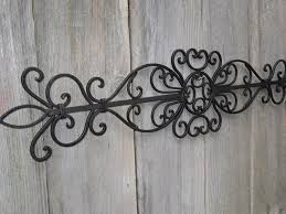 image of simple large wrought iron wall decor