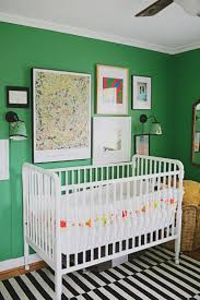 Love that green wall and the idea of such a bright color for a nursery.  Nice ideas for boys room.