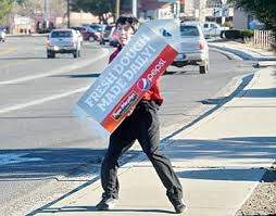 sign twirler young sign twirler finds niche in cottonwood with video