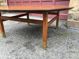 round wooden mid century coffee table brass feet