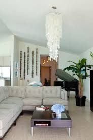 capiz shell chandelier living room decoration beige rug dark wood coffee table