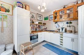 ... Glass front wooden cabinets and a custom refrigerator for the cool eclectic  kitchen [Design: