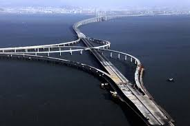 On the same day the bridge opened, the Qingdao Jiaozhou Bay tunnel opened.  It transects Jiaozhou Bay, also connecting Huangdao District and the city  of ...