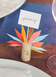 diy turkey feather thanksgiving place cards via almost makes perfect