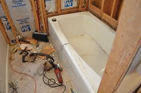 the wall sheathing was removed from around the old tub