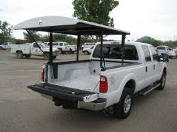 pickup truck bed cover... want to do this so I can sleep in the back ...