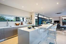 gas cooktop island. In A Sprawling Open-plan Space That Includes Living And Dining Areas, This Kitchen Gas Cooktop Island F