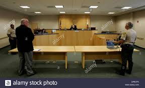 published 7 2 2006 n 2 june 30th 2006 vista california usacommissioner ernest gross middle presides over traffic court at the vista courthouse on