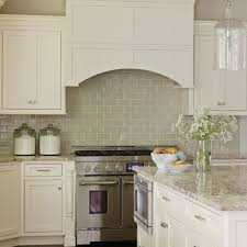 ivory kitchen cabinets with gray backsplash design