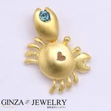 k18 yellow gold pendant top charm crab light blue stone