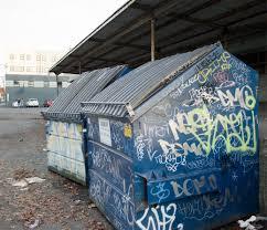 graffiti art or vandalism dumpster