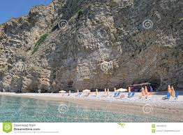 Paradise Beach Part Names Chomi Beach Of Liapades At Corfu Island (Greece).  Sedimentary Rock Cliff Of Chalk Rocks, Sun Chairs And Stock Image - Image  of europe, corfu: 123132377