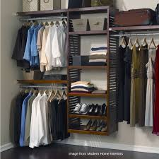 wood closet system with double hang single hand and angled shoe shelving