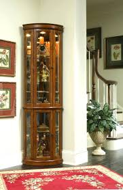 corner curio cabinet meallion howard miller duane black satin oak curved glass used cabinets for corner curio