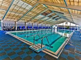 swimming pool complex offers an olympic size indoor and outdoor pool along with a child wading pool and changing rooms for further enjoyment and