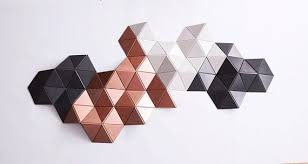 By incorporating texture and color onto an ordinary wall, homeowners are able to give their mundane living spaces a whimsically eccentric. Geometric Wood Art Copper Wall Art 3d Wall Sculpture 3d Etsy In 2021 Copper Wall Art Panel Wall Art 3d Wall Sculpture