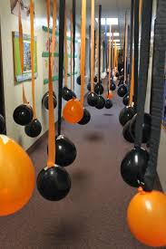 Haunt Your House: Balloon-Filled Hallway  For a kid-friendlier Halloween  hallway in your haunted house, consider hanging a billion orange and black  ...