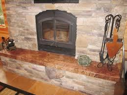 interior brick stone fireplace with black metal fire box on ceramics flooring plus black metal