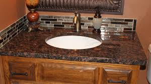 brown with black and gray flecks is one of the most popular granite at the world this granite works well on countertop and vanity tops