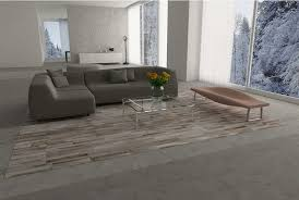 big gray beige and white patchwork cowhide rug designed in stripes in loft