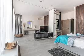 this room has an absolutely beautiful light colored hardwood floor the small grey carpet at the side of the bed makes for a perfect foot planting area