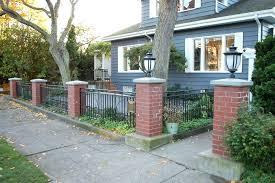 front yard fence. Front Yard Fence Ideas Brilliant Half Fences Using Black Iron Railing And Red Brick Pillars Plus Antique Lamp
