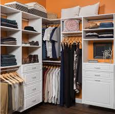 white walk in closet organization with clothing and accessories in st louis