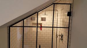 custom frameless glass shower enclosure with matte black hardware by exceptional glass of new jersey