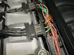 bmw e30 e36 valve cover replacement 3 series 1983 1999 it removed you can then reach in so that you can carefully pull the wire harnesses out of the way figure 12