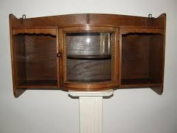 oak wall cabinet door with convex glass