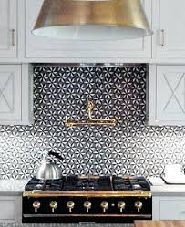 back it up to black and white black and white backsplash white cabinets black countertop blue