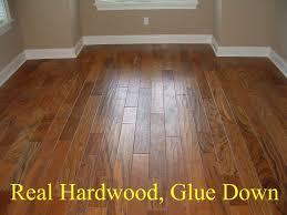 wood vs laminate flooring pros and cons wood laminate flooring