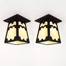 two matching antique arts crafts exterior flush mount light fixtures c 1910 made of cast iron with original amber slag glass each fixture is composed