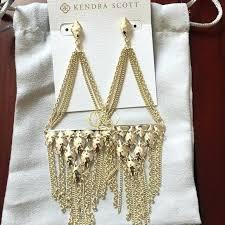 fearsome gold fringe chandelier earrings gold metallic foil fringe chandelier