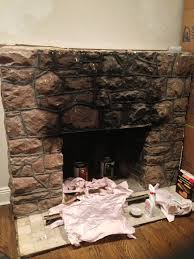 considering painting high gloss black with black mantle any other ideas to make this look acceptable or anyone have experience painting stone fireplace