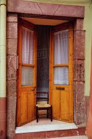 italy sarinia bosa old door ajar with chair