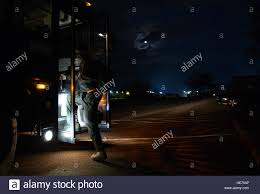 an 86th aerocal evacuation squadron member loads a bus after a preflight briefing at ramstein air