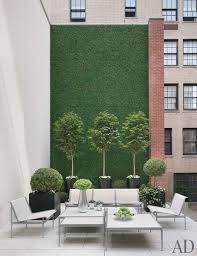 a masonry wall blanketed in synthetic grass
